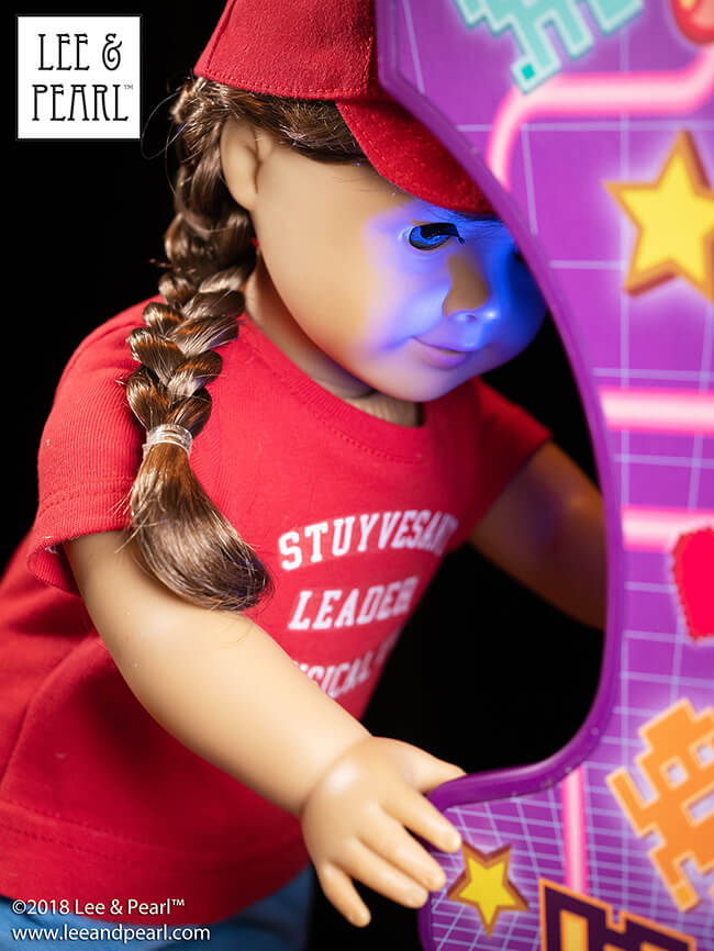 Our Big 80s American Girl doll loves her new My Life As… Retro Arcade from Walmart. We made her MTV-themed outfit using Lee & Pearl Pattern 1001: Unisex T-Shirt and Pattern 1008: Classic Ball Cap — and our COMING SOON Pattern 101: Gym Shorts. We also designed our own version of the iconic Stuyvesant Physical Ed Leader T-shirt, as seen in so many Beastie Boys videos. Click through to our website to download a FREE PRINTABLE PDF PACKAGE of this design for 18 inch, 16 inch and 14 1/2 inch dolls.