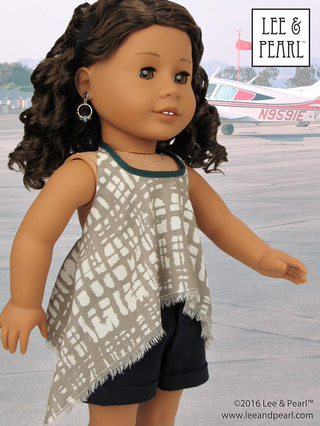 Make this trendy high-low handkerchief hem version of the Lee & Pearl Pattern 1032: Desert Sunrise Top or Maxi Dress for 18 inch dolls, like our American Girl doll, using our FREE tweak-the-pattern directions. Get the tweak — which also includes an Empire waist adaptation — in our June 2016 newsletter, available on our website at www.leeandpearl.com. And find Pattern 1032 in our Etsy shop at https://www.etsy.com/shop/leeandpearl