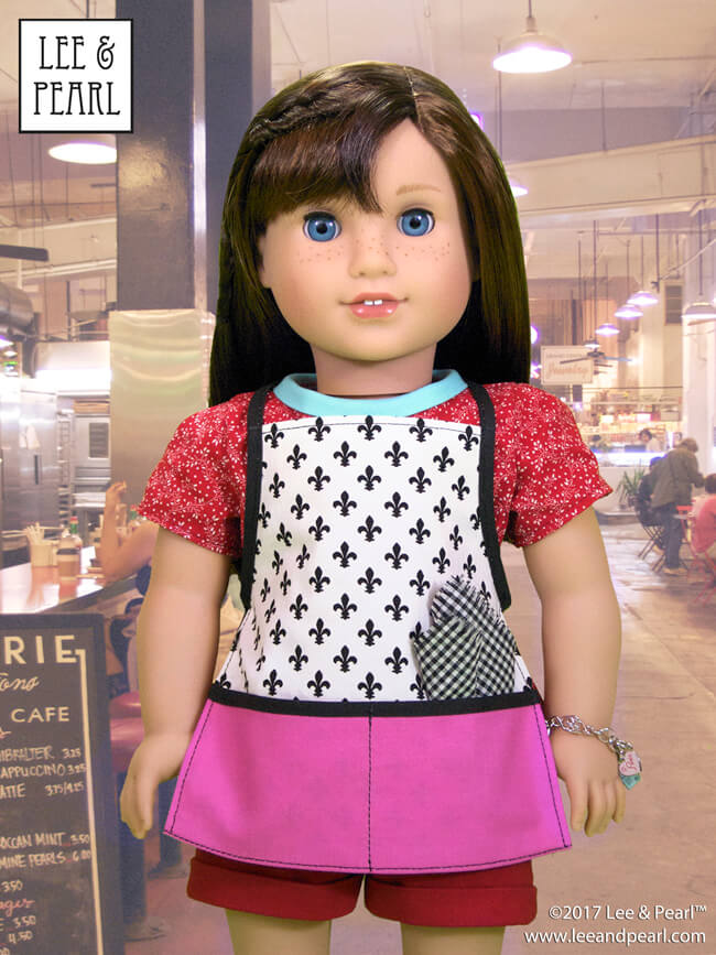 Who else is mesmerized by the Great British Baking Show this Christmas? Today, we're presenting baking-themed patterns for dolls, perfect for gifts, holiday scenes, sewing along to your favorite new TV show — and for Blaire Wilson, the COMING SOON 2019 American Girl Girl of the Year! Here's Pattern 1033: Bonjour, Paris Top, Dress, Shorts and Chef's Apron for 18 Inch Dolls, available in the Lee & Pearl Etsy store at https://www.etsy.com/listing/267357348/lp-1033-bonjour-paris-wardrobe-pattern