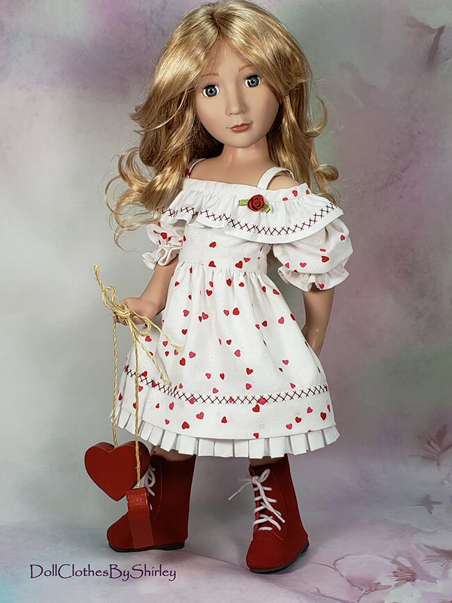 Happy Valentine's Day! We're thrilled that Shirley F. of DollClothesByShirley on Etsy — one of our favorite custom doll seamstresses — has graciously allowed us to share these pictures of her A Girl for All Time® dolls wearing the holiday themed dresses she made using Lee & Pearl Pattern 1035: Olá Brasil for 18 Inch, 16 Inch and 14 1/2 Inch Dolls. Thank you, Shirley!