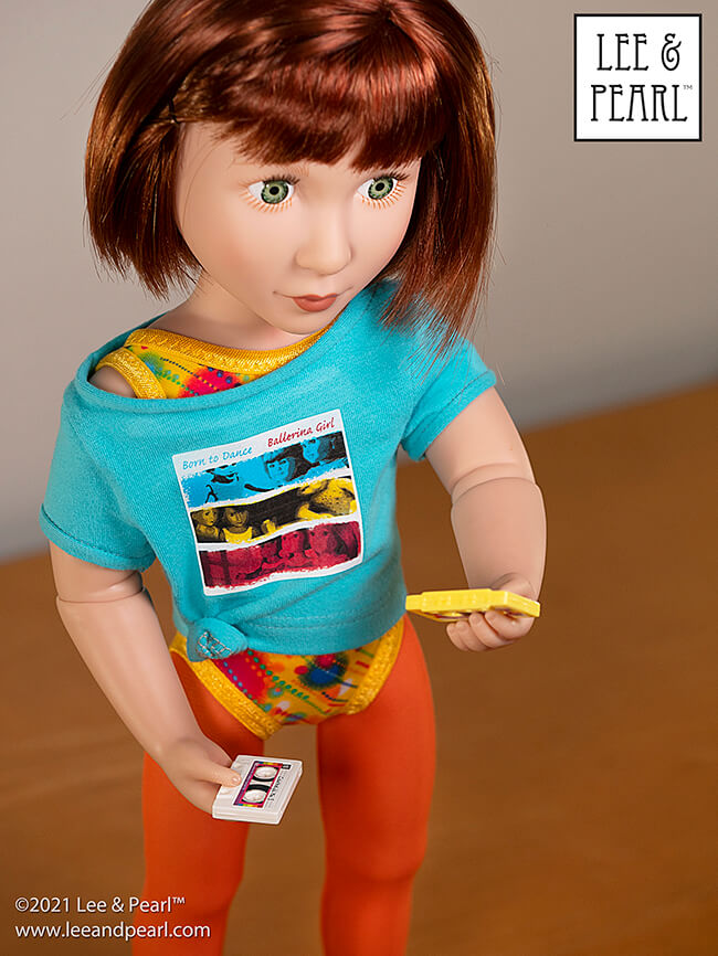 Introducing Pattern 1983: She's a Maniac Off-One-Shoulder Workout T-Shirt for Dolls! We're proud to present this brand new '80s / aerobics / workout and dance-inspired pattern for 18 inch American Girl®, 16 inch A Girl for All Time® and 14 ½ inch WellieWishers™ and similar dolls, now available in the Lee & Pearl Etsy store.