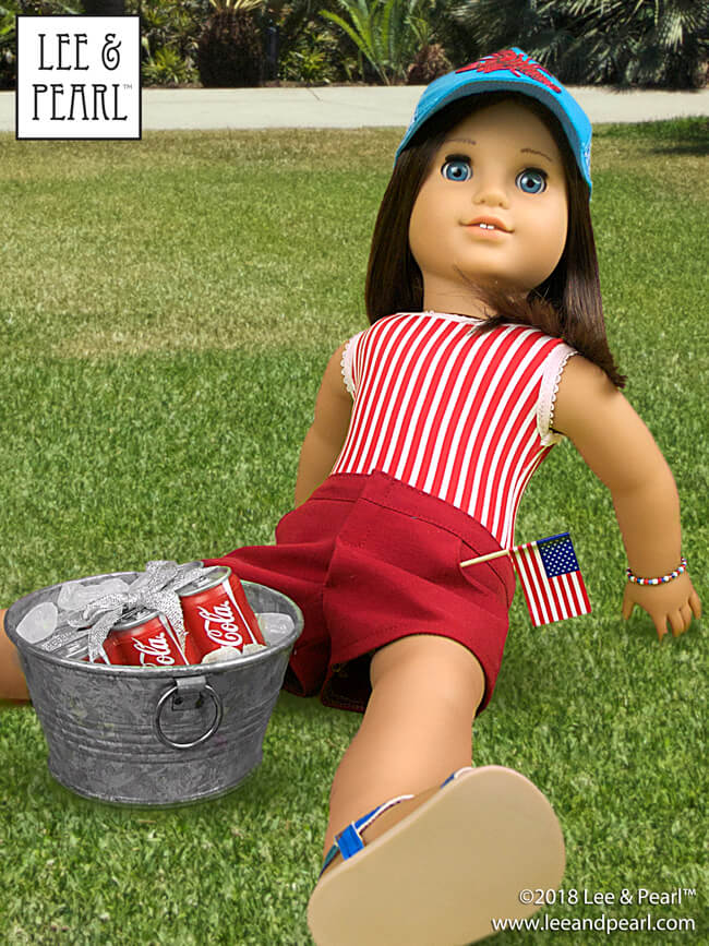 "Happy July 4th! Our American Girl™ Chrissa wears a striped swimsuit, made using Lee & Pearl Pattern #1051: Ballet Basics Leotard & Unitard for 18"" Dolls. Her red shorts are made using Lee & Pearl Pattern #1033: Bonjour, Paris Mini Wardrobe for 18"" Dolls, and her picnic-ready cap comes from Lee & Pearl Pattern #1008: Classic Ball Cap and Big Fat Trucker Hat for 18"" Dolls. Find these patterns in our Etsy store at https://www.etsy.com/shop/leeandpearl"