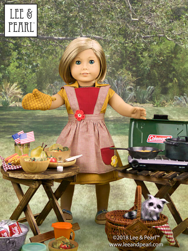 "Happy July 4th! Our American Girl™ Kit has everything ready for the picnic. Kit's wearing a sunny yellow cotton wrap dress from Lee & Pearl Pattern #1031: Classic Wrap Dress and Peplum Top for 18"" Dolls. Her gingham apron and diamond-stitched oven mitt come from L&P Pattern #1022: Cookie Time Apron, Pinafore and Oven Mitt for 18"" Dolls. These patterns are available in our Etsy shop at https://www.etsy.com/shop/leeandpearl"