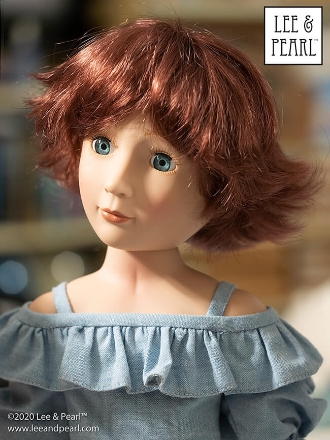 Every girl loves a new 'do! Here's our A Girl for All Time® doll Amelia wearing a Monique Roxie wig, size 8-9 in Burgundy. We think she looks so adorable in this retro-style hairdo that we're going to have to make a new Lee & Pearl pattern to go with it. Stay tuned!