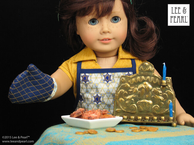 Happy Chanukah from Lee & Pearl! Make your 18 inch dolls, like our American Girl® Lindsey, their very own pressed metal Chanukah Menorah (Chanukiya) using a dollar store cookie sheet, cardboard, glue, plastic beads, a knitting needle, metallic paints and the techniques in our easy VIDEO TUTORIAL.