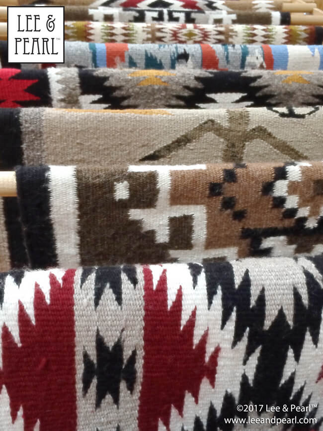 Join Lee & Pearl™ for a month on the road: woven rugs in the Museum of Northern Arizona gift shop.