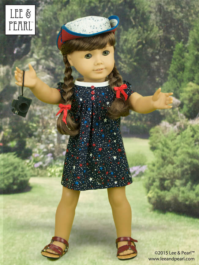 "It can't be the Fourth of July without American Girl™ Molly!Our spirited girl looks every inch the patriot in a star-spangled dress made using Lee & Pearl Pattern #1033: Bonjour, Paris Mini Wardrobe for 18"" Dolls and her jaunty sunhat was made using L&P #1007: Bush Hat or ""Boonie"" for 18"" Dolls. These patterns are available in our Etsy shop at https://www.etsy.com/shop/leeandpearl Molly's tiny camera is a Kikkerland LED keychain — a must-have dolly accessory in our book."